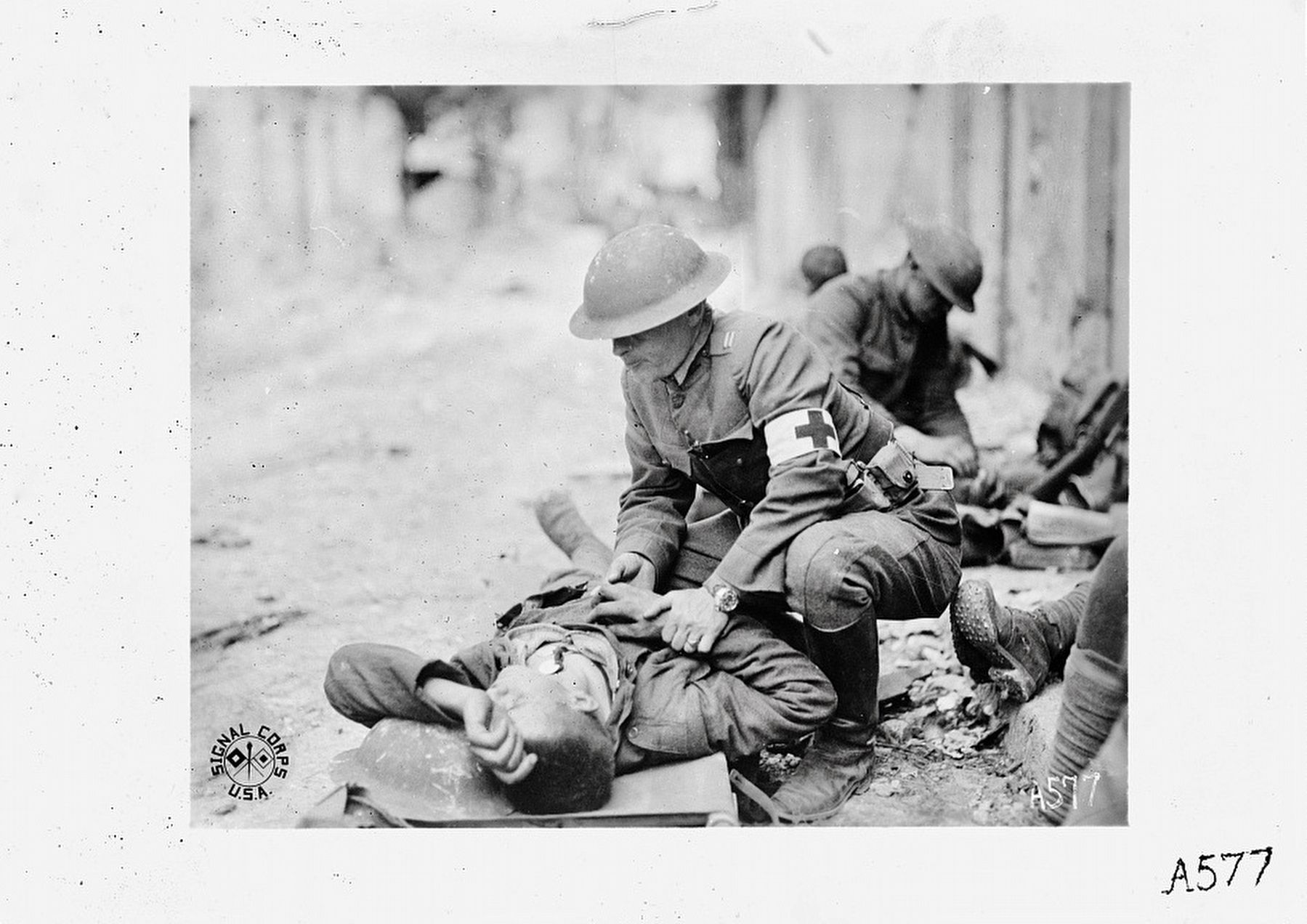 <i>...Giving first aid to the wounded at Chateau Thierry, France....</i> image. Click for full size.