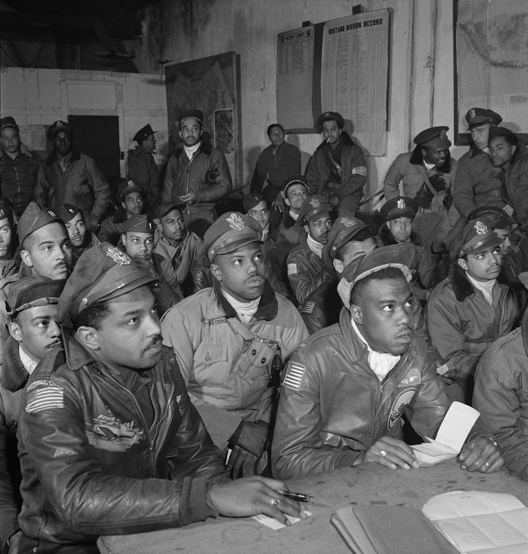 <i>Photograph of several Tuskegee airmen attending a briefing in Ramitelli, Italy, March 1945</i> image. Click for full size.