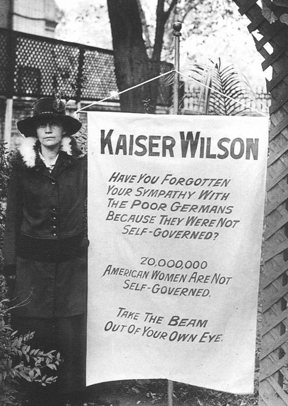 Virginia Arnold holding the Kaiser Wilson banner image. Click for full size.