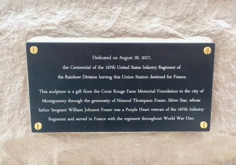 Dedication plaque at rear of statue. image. Click for full size.