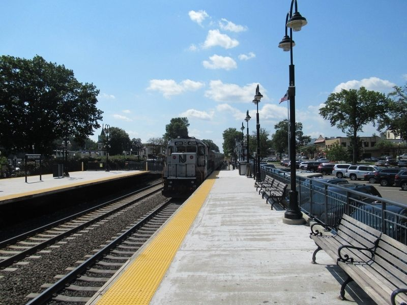 A NJ Tansit train departs the Ridgewood Train Station southbound, heading to Hoboken. image. Click for full size.