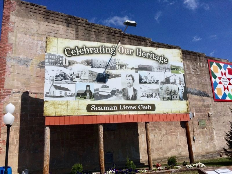 Billboard across street from marker showing town of Seaman's past. image. Click for full size.