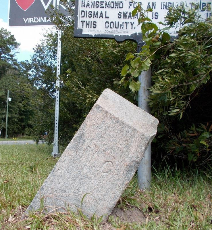 A closeup of the boundary marker's south side. image. Click for full size.