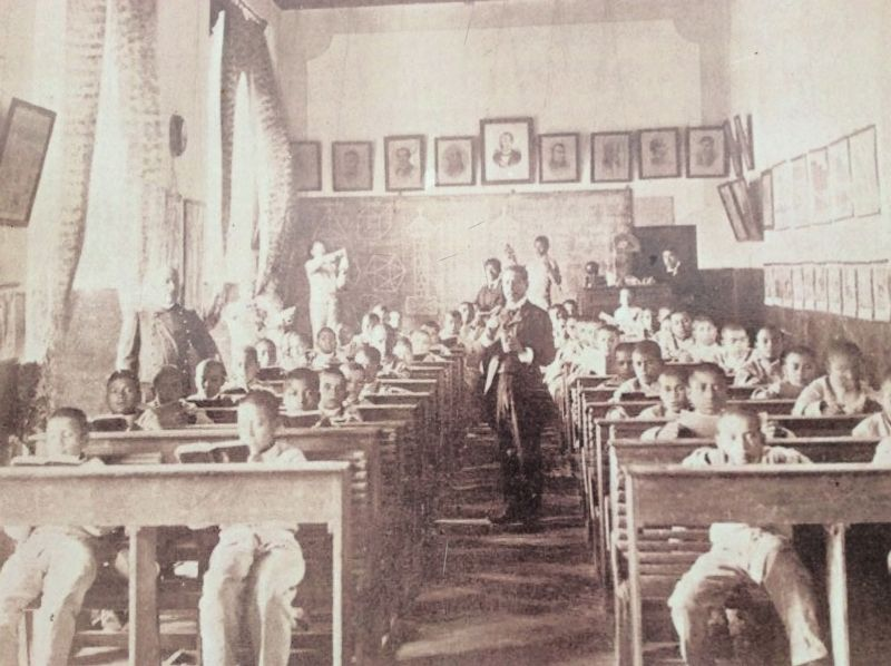 A Model School classroom, taken from the marker. image. Click for full size.