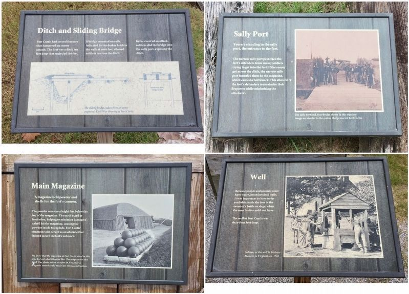 Signs around the reconstructed replica fort. image. Click for full size.