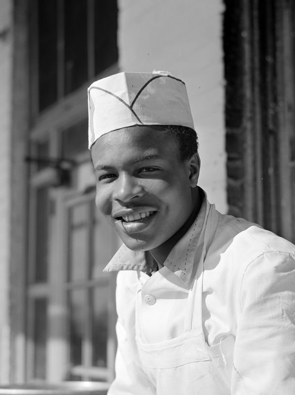 Washington, D.C. Cook who works in one of the seafood restaurants in the fish market district image. Click for full size.