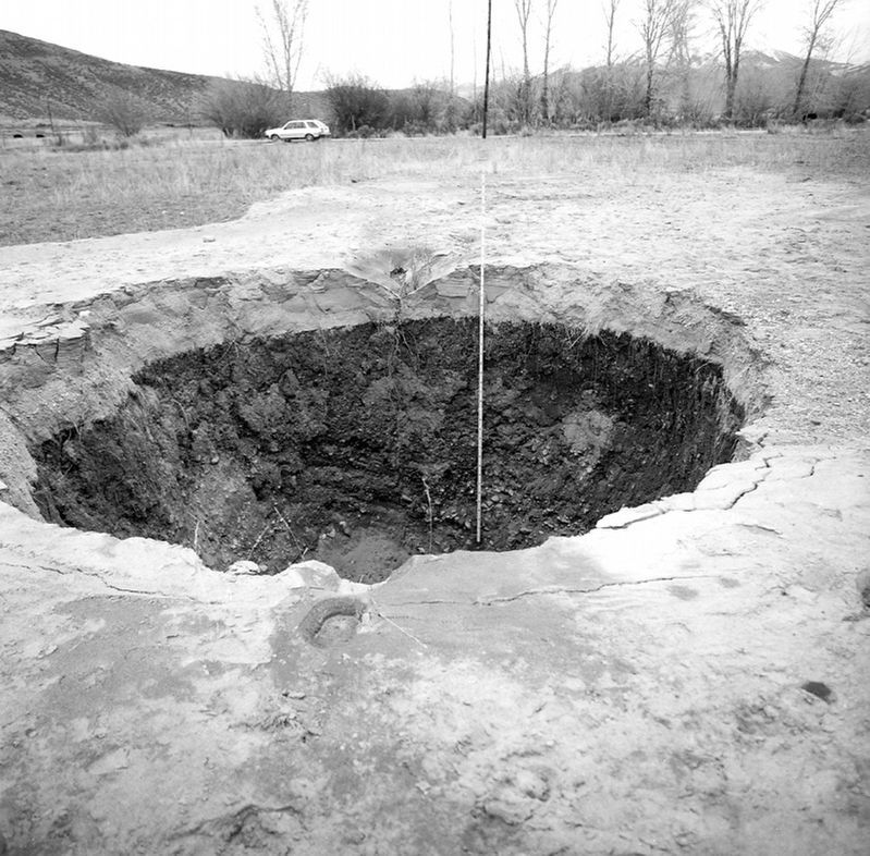 Crater caused by an artesian fountain (sand blow). image. Click for full size.