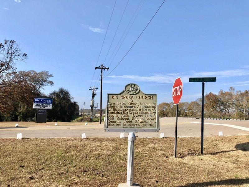 View of marker and church sign at intersection of U.S. 84 and Big Creek Church Road. image. Click for full size.