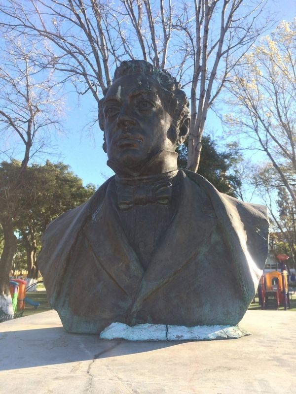 A bust of Bernardino Rivadavia tops the monument image. Click for full size.