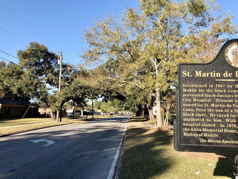 View of marker looking north on South Washington Avenue. image. Click for full size.
