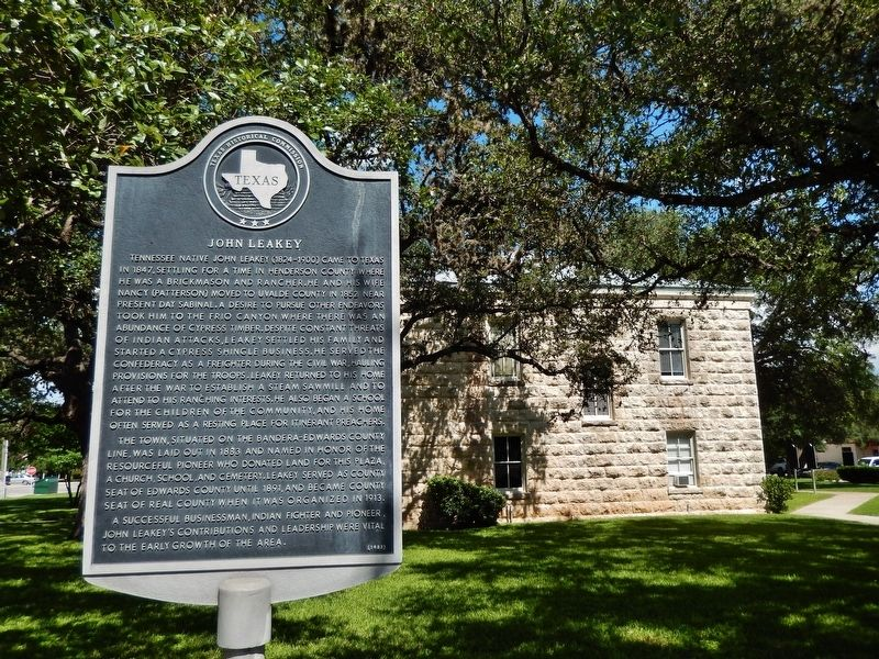 John Leakey Marker (<i>wide view; Real County Courthouse in background</i>) image. Click for full size.
