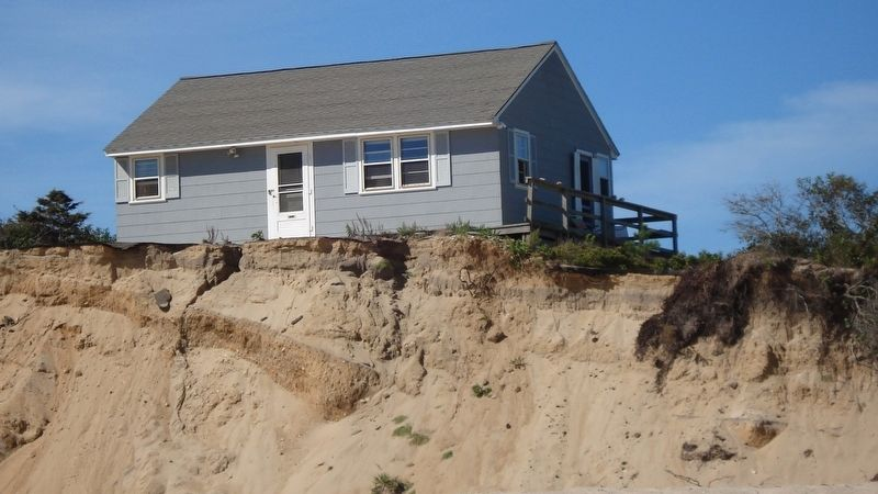 This house located 1 mile down the beach has so far survived. image. Click for full size.