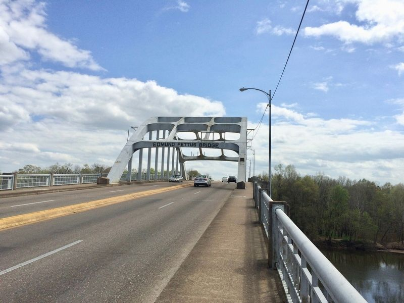 The Edmund Pettus Bridge, just beyond the marker on far left background. image. Click for full size.