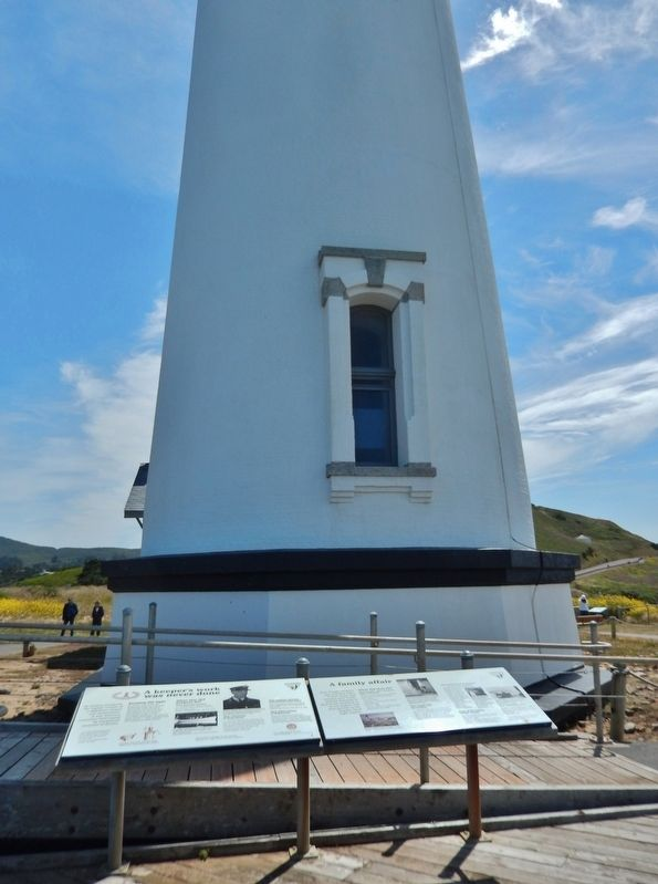 A Family Affair Marker (<i>wide view showing adjacent marker; lighthouse in background</i>) image, Touch for more information