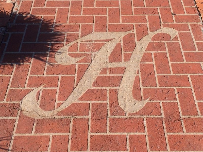 The Hinton House decorative 'H' on the entry walkway. image. Click for full size.