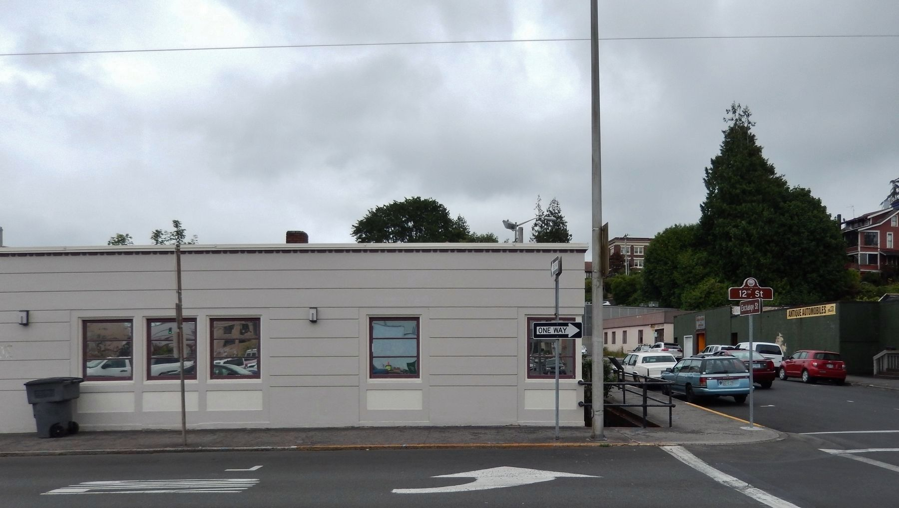 Former Astoria Theater site; marker visible beyond street sign, at right side of building image. Click for full size.