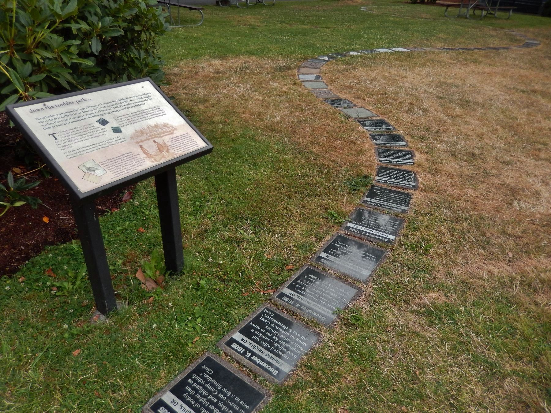 """down the trodden path..."" Marker (<i>wide view; showing black granite tiles along the path</i>) image. Click for full size."