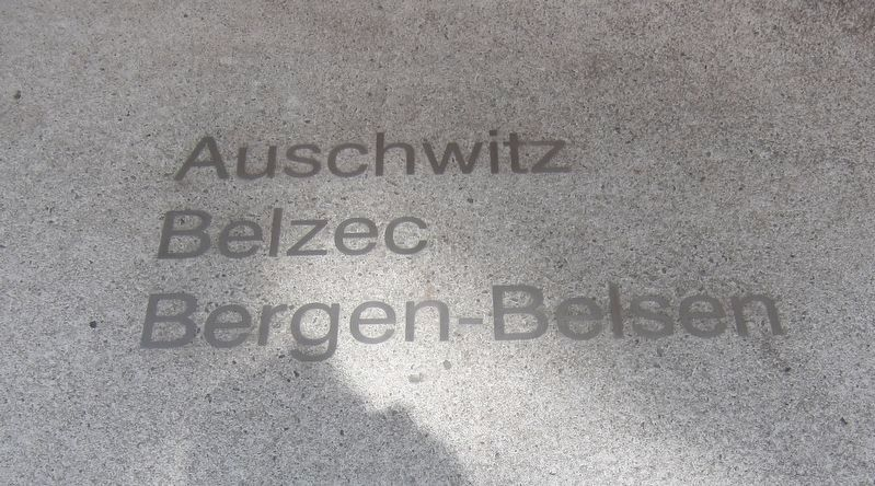 Example of concentration camp names surrounding the memorial image. Click for full size.
