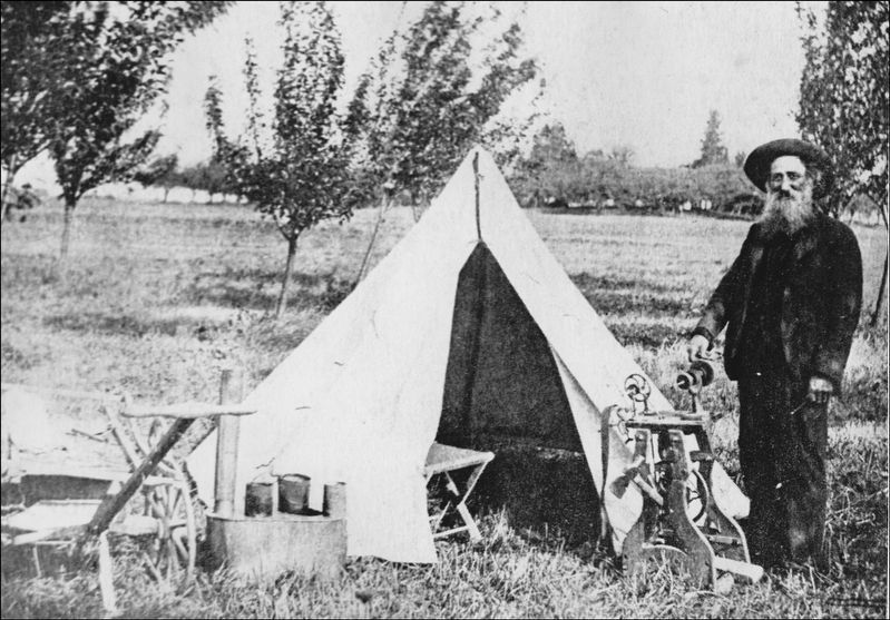 Old Shep with his tent and grindstone. image. Click for full size.