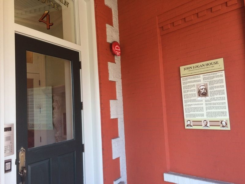 An identical marker is adjacent to the front door of the house. image. Click for full size.