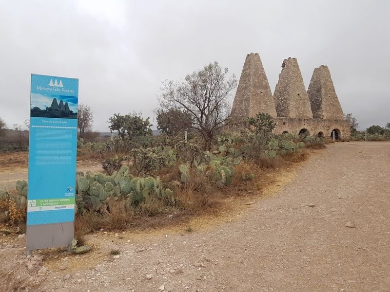 The Santa Brígida Mine Marker and the Jesuit adobe furnaces to the right image. Click for full size.