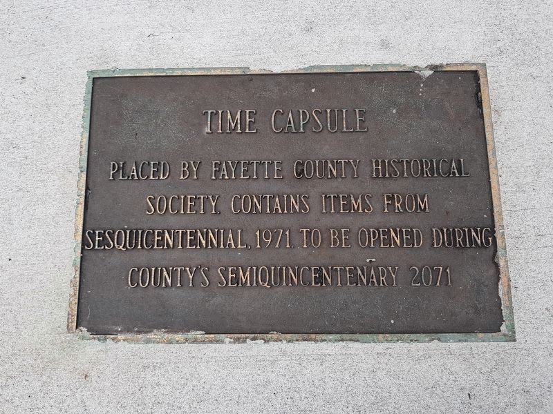 A time capsule marker near the World's Longest Courthouse Bench Marker image. Click for full size.