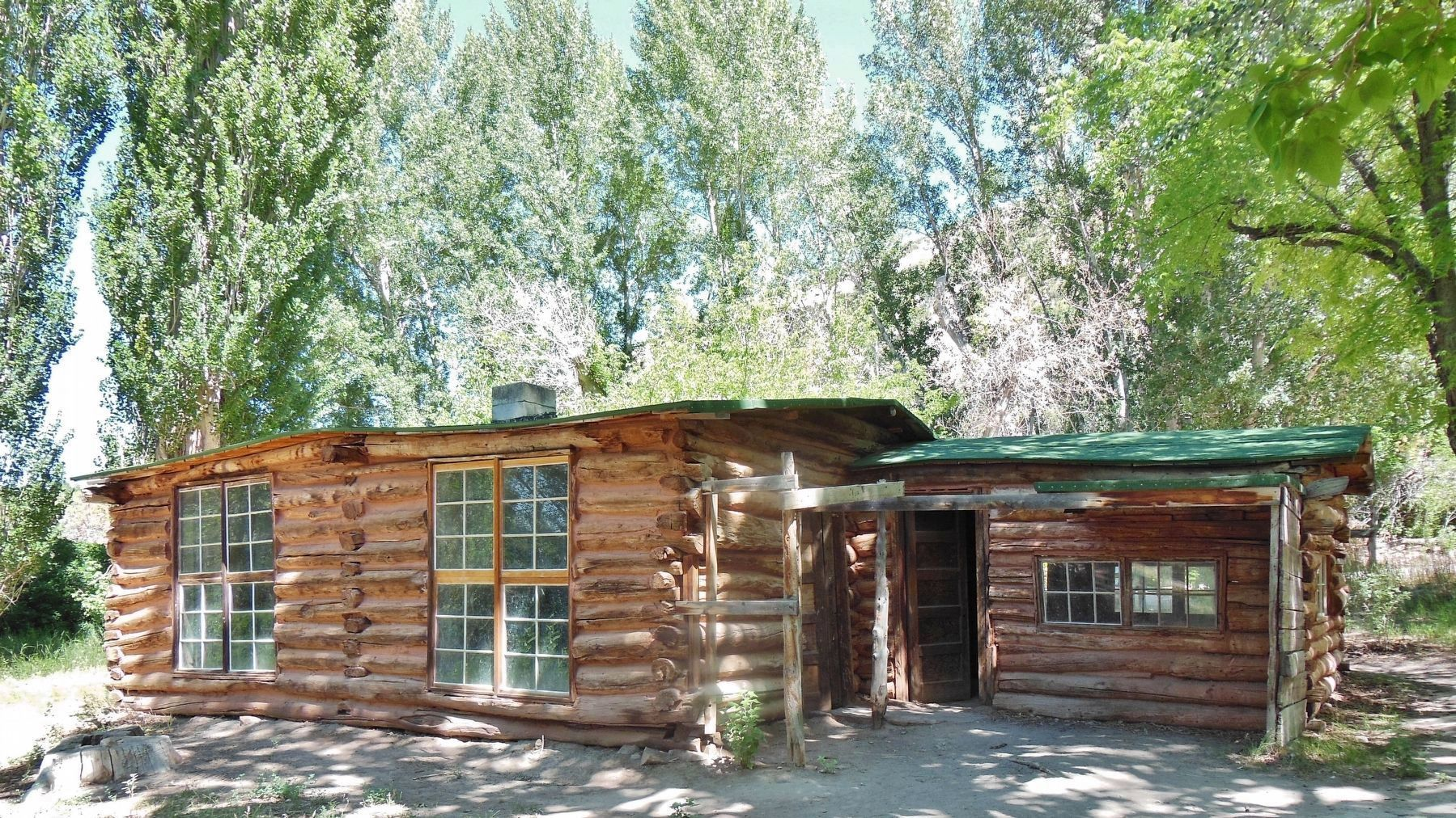 Josie Morris Homestead Cabin (<i>surrounded by the trees she planted</i>) image. Click for full size.