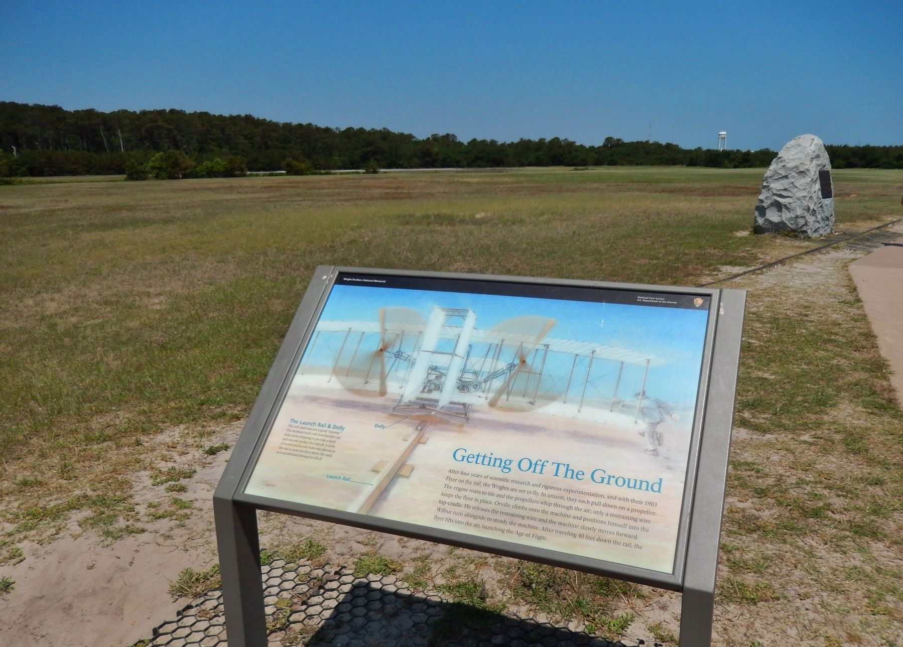 Getting Off the Ground Marker (<i>wide view; First Flight Monument in background, right</i>) image. Click for full size.