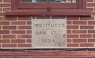 """Instituted Jan 17 1824"" cornerstone, embedded in brick, 2nd floor image. Click for full size."