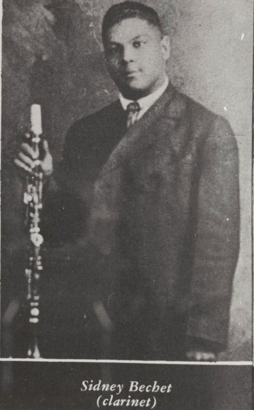 <i>Three-quarter length portrait of jazz saxophonist, clarinetist and composer Sidney Bechet...</i> image. Click for full size.
