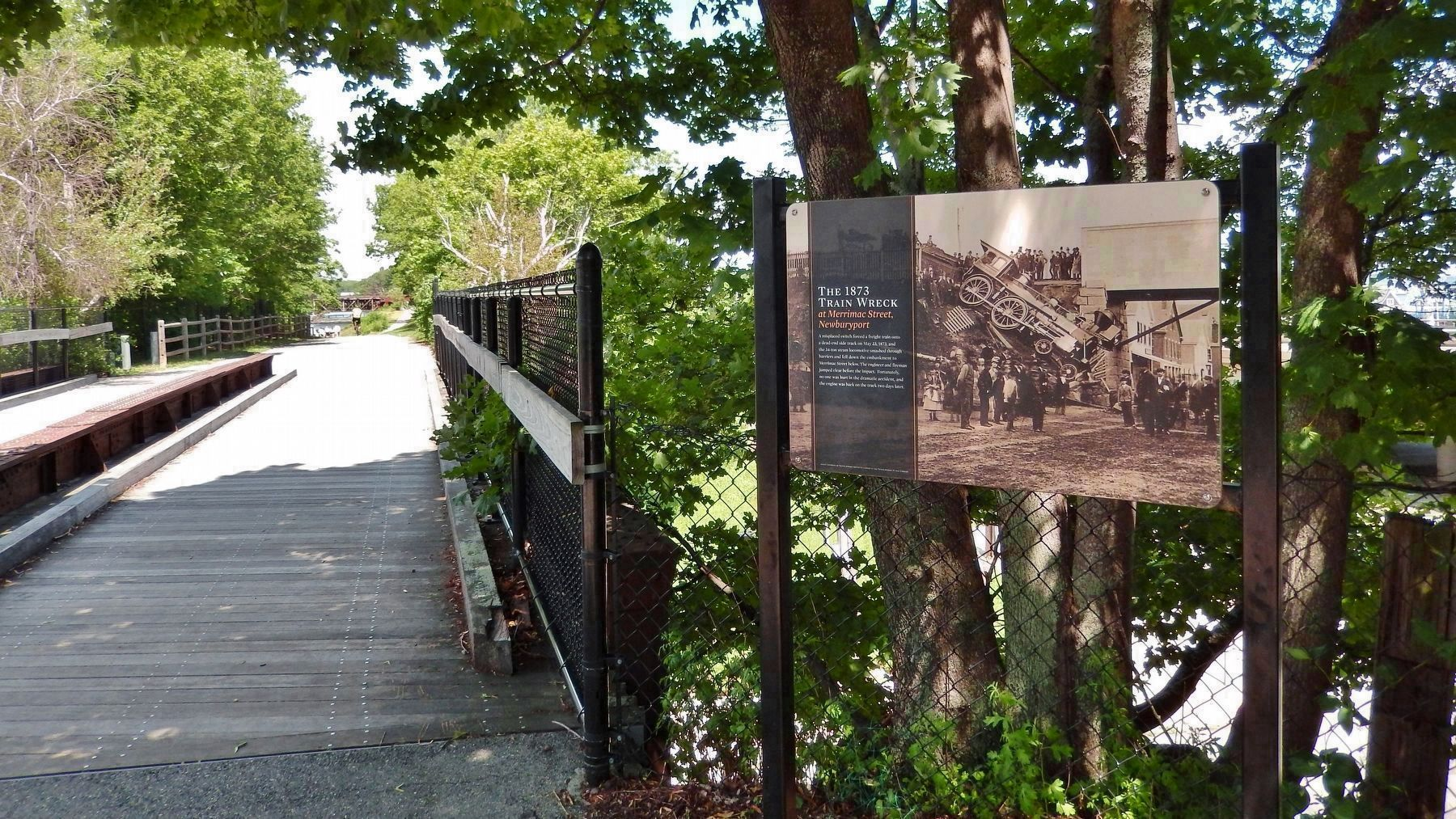 The 1873 Train Wreck Marker (<i>wide view; looking north across the Merrimac Street bridge</i>) image. Click for full size.