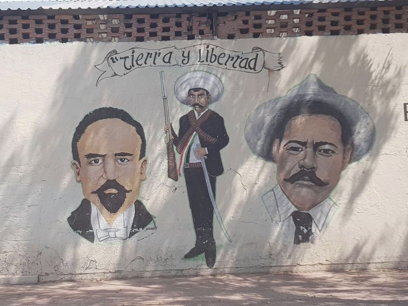 A nearby mural of Zapata flanked by Madero and Villa image. Click for full size.
