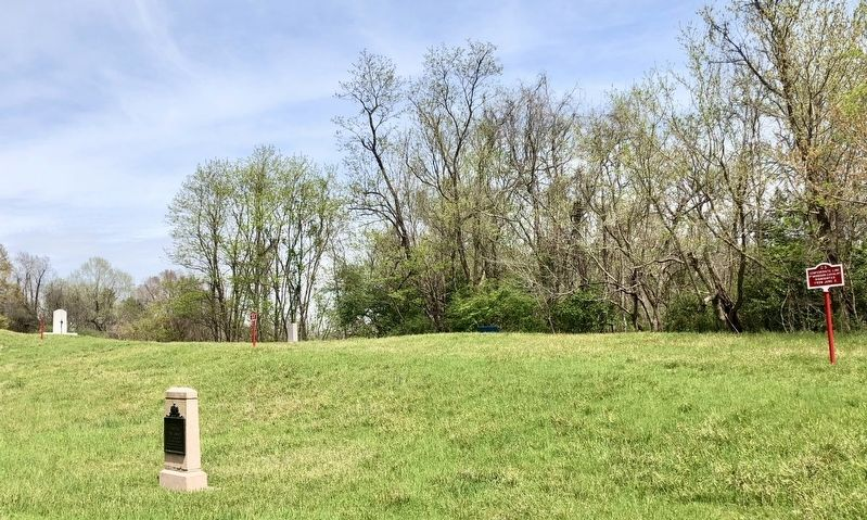 View looking east from Confederate Avenue to marker, just right of center, in the tree line. image. Click for full size.