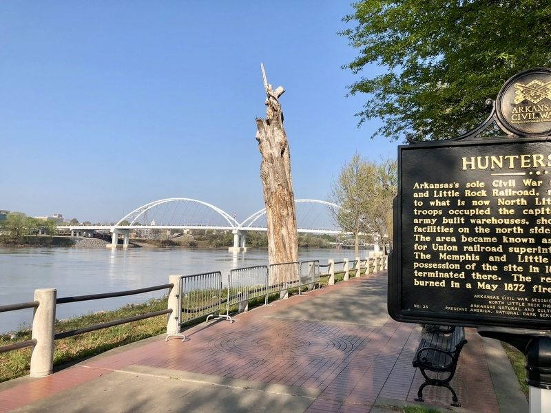 View of marker looking west on the Arkansas River & the Broadway Bridge. image. Click for full size.