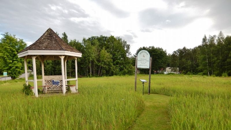 Site of Sinclair Hotel Marker (<i>wide view; marker visible under sign, right of gazebo</i>) image. Click for full size.
