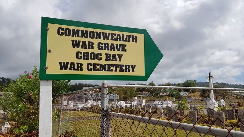 Choc Bay War Cemetery entrance sign image. Click for full size.