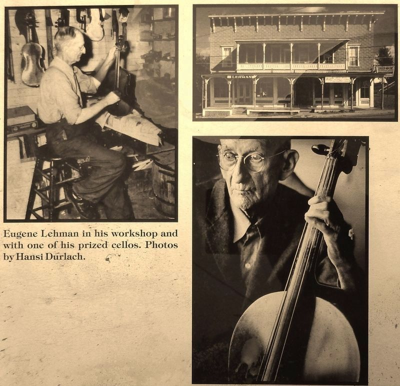Marker detail: Eugene Lehman in his workshop and with one of his prized cellos image. Click for full size.