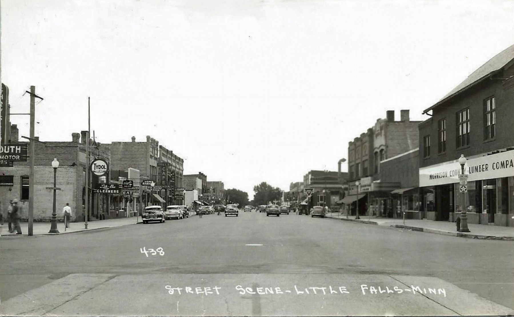 <i>Street Scene - Little Falls - Minn.</i> - Looking north, W. Tonn Block on the left image. Click for full size.