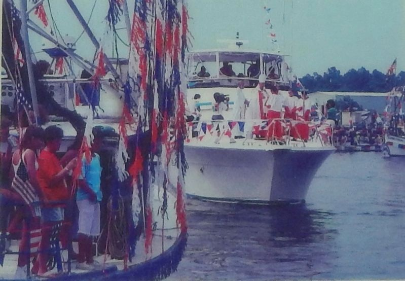 Marker detail: Crowds gather as the Archbishop blesses each boat in the Bayou La Batre fleet image. Click for full size.