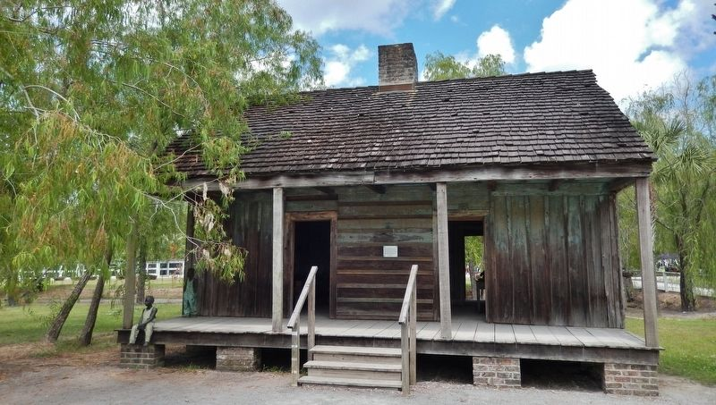 The Slave Quarters Marker (<i>wide view; marker visible at center of building, between doors</i>) image. Click for full size.