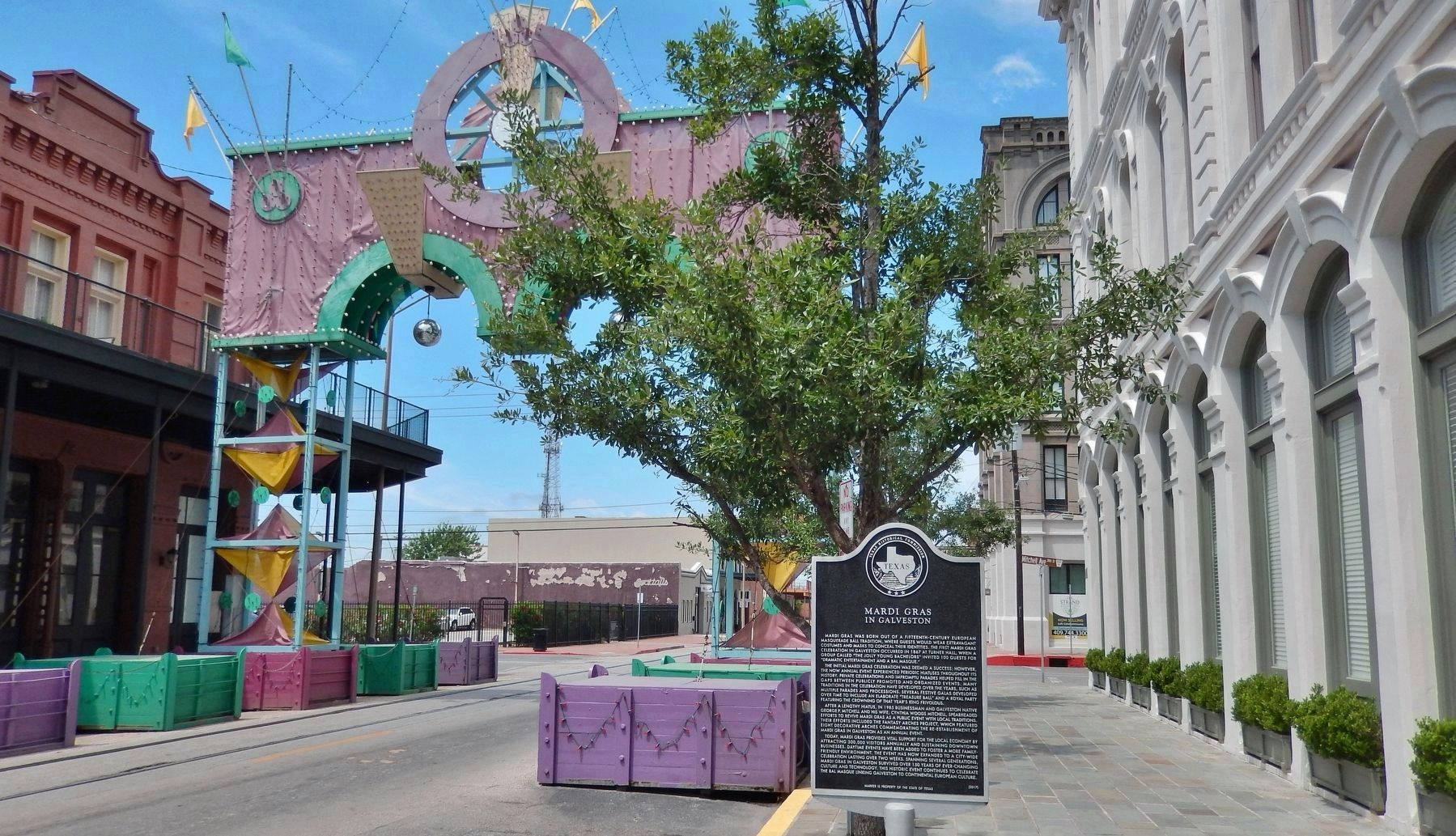 Mardi Gras in Galveston Marker (<i>wide view; showing Mardi Gras Arch in street at left</i>) image. Click for full size.