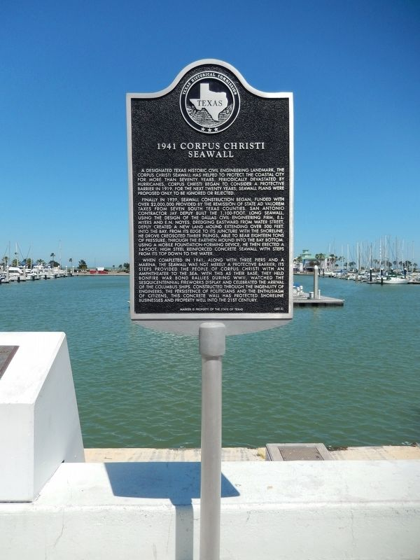 1941 Corpus Christi Seawall Marker (<i>tall view</i>) image. Click for full size.