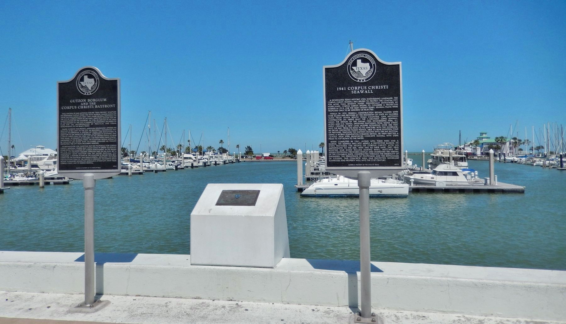 1941 Corpus Christi Seawall Marker (<i>wide view; plaque in center & adjacent marker far left</i>) image. Click for full size.