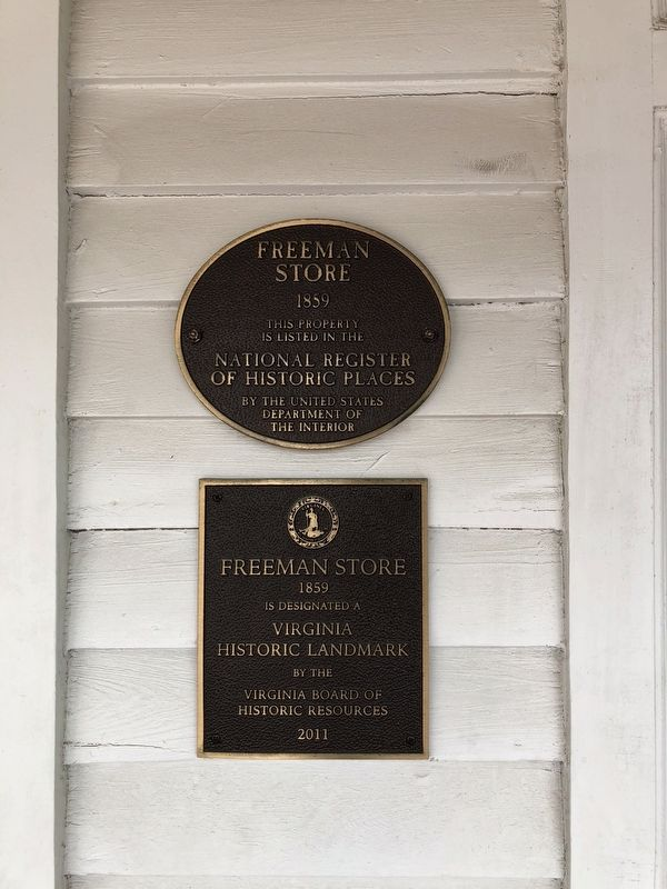 National Register plaque on the building image. Click for full size.