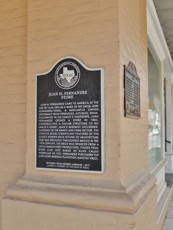 Juan H. Fernandez Store Marker (<i>tall view; northeast corner of building; facing Adams Street</i>) image. Click for full size.