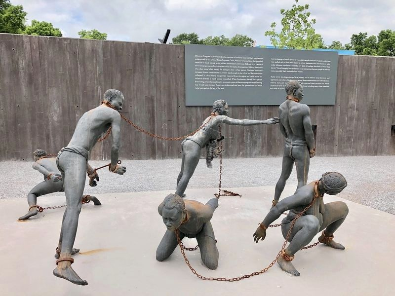 African slaves in chains statue next to marker. image. Click for full size.