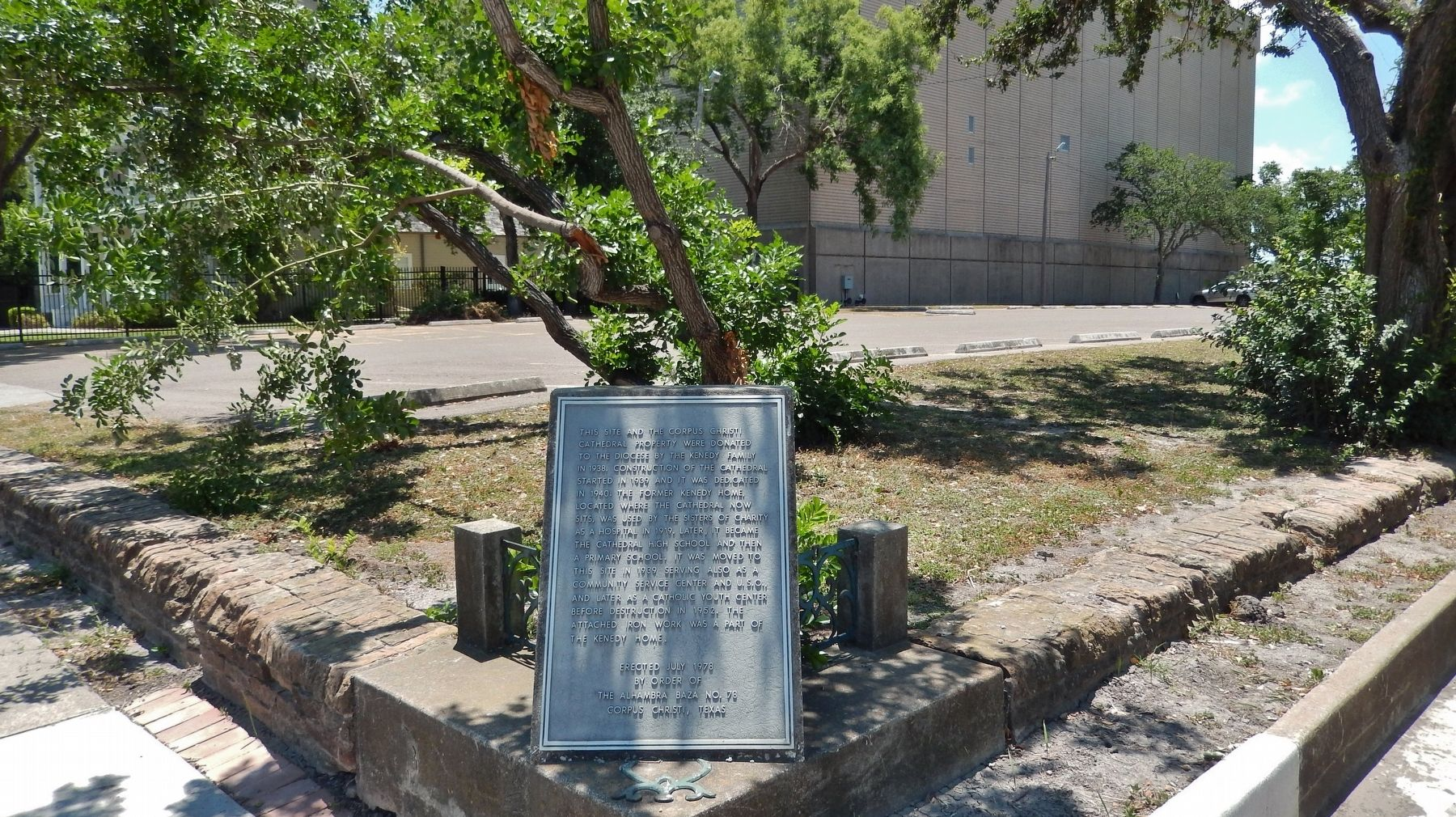 Corpus Christi Cathedral Site Marker (<i>wide view showing wrought iron pieces from Kenedy home</i>) image. Click for full size.
