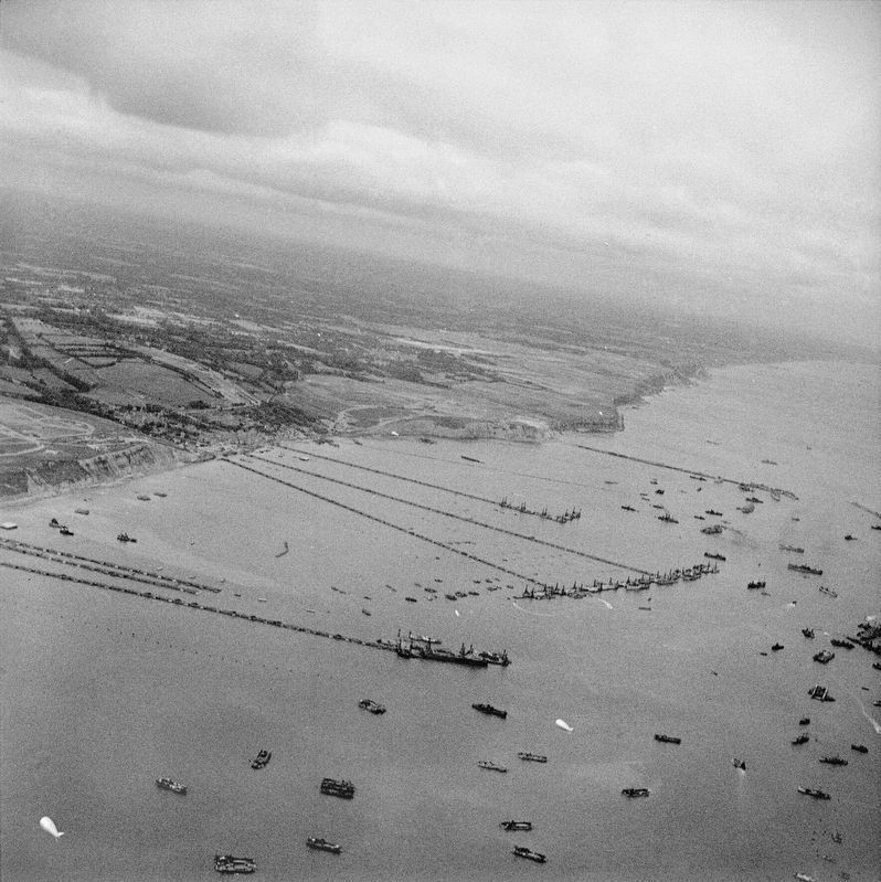 The Mulberry artificial harbour off Arromanches in Normandy image. Click for full size.