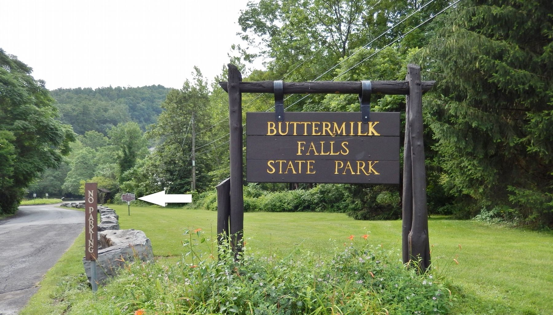 Buttermilk Falls State Park entrance (<i>marker visible in background beside road</i>) image. Click for full size.