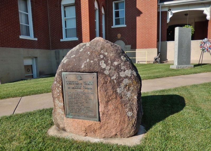 Revolutionary Soldiers Marker (<i>marker on boulder; Washington County Courthouse in background</i>) image. Click for full size.
